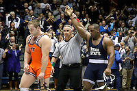 STATE COLLEGE, PA -DECEMBER 19: 285 pounder Jimmy Lawson of the Penn State Nittany Lions gets his hand raised by the referee after defeating Ty Walz of the Virginia Tech Hokies in overtime on December 19, 2014 at Recreation Hall on the campus of Penn State University in State College, Pennsylvania. Penn State won 20-15. (Photo by Hunter Martin/Getty Images) *** Local Caption *** Jimmy Lawson;Ty Walz
