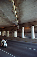 Scooter speeding out of the underpass