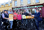 21-9-2017: Fran Whearty, Communications Executive, The National Lottery cracks open a bottle of champagne with Mary Murphy, Post Mistress, Rerrin Post Office on Bere Island in County Cork after she sold a 500,000 Euro Millions Plus ticket pictured celebrating on Thursday with family, Kitty Murphy-Walker, Edel Murphy, Albert Walker, Mary Murphy, Edel Murphy and Brendan Murphy.<br />  Photo: Don MacMonagle<br /> <br /> Issued on behlf of The National Lottery