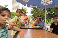 Children and an adult enjoy the production of an Oriental pastry workshop held by the non-profit association Batisseusses de Paix (or Women Peace Builders) that seeks to build ties between Muslim and Jewish women, in a restaurant in Creteil, outside Paris, France, 24 June 2008.