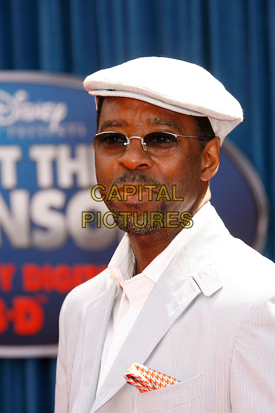 """COURTNEY B. VANCE.Attending the """"Meet The Robinsons"""" Los Angeles Premiere held at the El Capitan Theatre, Hollywood, California, USA, 25 March 2007..portrait headshot cap hat glasses.CAP/ADM/RE.©Russ Elliot/AdMedia/Capital Pictures."""