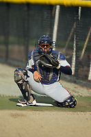 Danville Braves catcher William Contreras (24) warms up the pitcher in the bullpen prior to the game against the Burlington Royals at Burlington Athletic Stadium on August 14, 2017 in Burlington, North Carolina.  The Royals defeated the Braves 9-8 in 10 innings.  (Brian Westerholt/Four Seam Images)