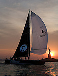 The Tutima DK-46 sailing yacht, based in Germany, sails in front of  the the Statue of Liberty at sunset Thursday, June 7, 2007 in New York Harbor. The German based 46 foot yacht was visiting New York prior to its 3600 mile race across the atlantic ocean which begins June 16, 2007 in Newport, R.I. (Photo/ Victoria Arocho Rocka*Rho Publishing)