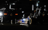 Nov 13, 2010; Pomona, CA, USA; The car of NHRA top fuel dragster driver Antron Brown is towed back to the pits during qualifying for the Auto Club Finals at Auto Club Raceway at Pomona. Mandatory Credit: Mark J. Rebilas-