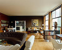 The large light-filled south facing living room is filled with furniture by Gwynne and designers such as Saarinen and Eames