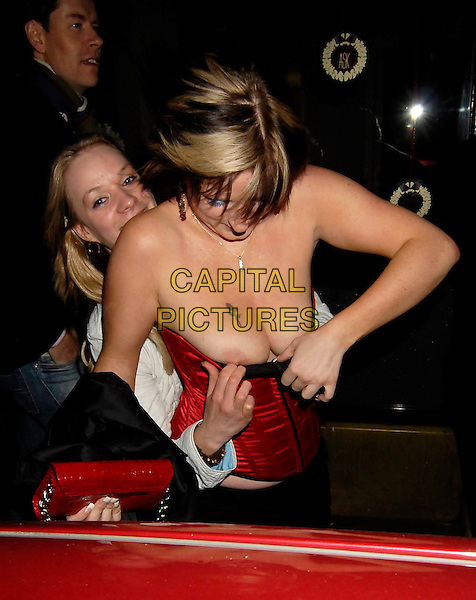 GIRLS.At Chinawhite, London, UK.January 10th, 2007.half length red corset bustier nipples flashing breasts tattoo basque .CAP/SW.©Stephen Walters/Capital Pictures