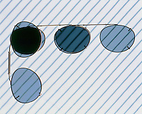 POLARIZED LIGHT<br /> Polarized Sunglass Lenses At 90 Degrees & Aligned.When lenses are at a 90 degree angle to each other there is no transmission of light.  When lenses are aligned the transmitted light has maximum intensity.