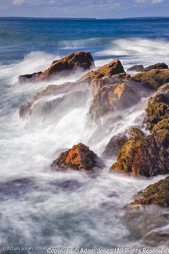 Long exposure of wave crashing against rocky coastline, Acadia National Park, Maine