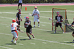 Orange, CA 05/02/10 - Andrew Hauke (CS Fullerton # 2) shoots on Jonathan Lowell (Biola # 10)'s goal as Victor Blais (Biola # 3) rushes him during the Biola-Cal State Fullerton MCLA SLC Division II final game in Wilson Field at Chapman University.  CS Fullerton earned a consecutive appearance at the Nationals by defeating Biola 12-7.