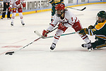 ST CHARLES, MO - MARCH 19:  Jenny Ryan (5) of the Wisconsin Badgers gets by Corie Jacobson (2) of the Clarkson Golden Knights during the Division I Women's Ice Hockey Championship held at The Family Arena on March 19, 2017 in St Charles, Missouri. Clarkson defeated Wisconsin 3-0 to win the national championship. (Photo by Mark Buckner/NCAA Photos via Getty Images)