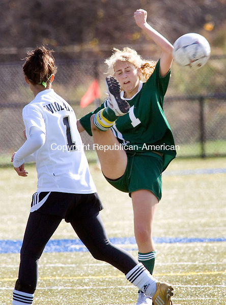 WATERBURY, CT. 30 October 2010-103010SV07--#1 Andrea Broderick of Holy Cross High cleas a ball past #1 Marissa Mills of Woodland High during NVL soccer action in Waterbury Saturday.<br /> Steven Valenti Republican-American