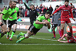 Munster fullback Felix Jones dives over to score in the corner.<br /> Guiness Pro12<br /> Scarlets v Munster<br /> 21.02.15<br /> ©Steve Pope -SPORTINGWALES