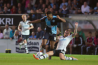 Jamie O'Hara of Fulham slides in to tackle Aaron Amadi Holloway of Wycombe Wanderers during the Capital One Cup match between Wycombe Wanderers and Fulham at Adams Park, High Wycombe, England on 11 August 2015. Photo by Andy Rowland.