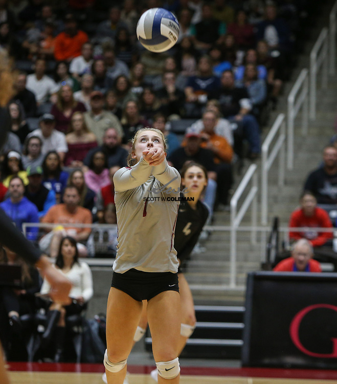 Rouse Raiders senior Katy Northcut (1) digs the ball during the Class 5A high school volleyball state final between Rouse High School and Prosper High School at Curtis Culwell Center in Garland, Texas, on November 18, 2017. Prosper won the match in five sets, (25-18, 21-25, 18-25, 25, 23, 16-14) to win the 5A state championship.