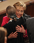 Washington, D.C. - February 24, 2009 -- United States Secretary of State Hillary Rodham Clinton hugs Associate Supreme Justice Ruth Bader Ginsburg as they await the arrival of United States President Barack Obama to deliver an address to a Joint Session of Congress in the United States Capitol in Washington, D.C. on Tuesday, February 24, 2009..Credit: Ron Sachs / CNP.(RESTRICTION: NO New York or New Jersey Newspapers or newspapers within a 75 mile radius of New York City)