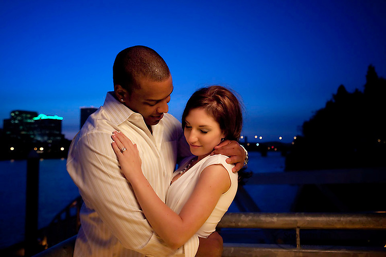 Couple looking at each other during romantic engagement session.