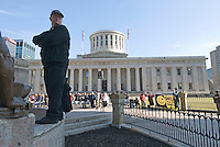 A priest stands sentinel on the edge of a statue at the beginning of a Pro-Life rally at the Statehouse in Columbus, Ohio, Monday, Nov. 23, 2006, on the 33rd anniversary of the Supreme Court Roe v. Wade decision.<br />