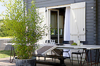 The grey and white theme continues outside on the spacious terrace where there is ample room for a large garden table and chairs