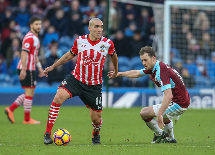 Southampton's Oriol Romeu gets away form Burnley's Ashley Barnes<br /> <br /> Photographer Alex Dodd/CameraSport<br /> <br /> The Premier League - Burnley v Southampton - Saturday 14th January 2017 - Turf Moor - Burnley<br /> <br /> World Copyright &copy; 2017 CameraSport. All rights reserved. 43 Linden Ave. Countesthorpe. Leicester. England. LE8 5PG - Tel: +44 (0) 116 277 4147 - admin@camerasport.com - www.camerasport.com