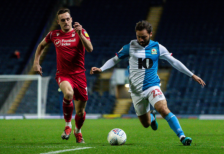 Blackburn Rovers' Bradley Dack competing with Nottingham Forest's Jack Robinson (left) <br /> <br /> Photographer Andrew Kearns/CameraSport<br /> <br /> The EFL Sky Bet Championship - Blackburn Rovers v Nottingham Forest - Tuesday 1st October 2019  - Ewood Park - Blackburn<br /> <br /> World Copyright © 2019 CameraSport. All rights reserved. 43 Linden Ave. Countesthorpe. Leicester. England. LE8 5PG - Tel: +44 (0) 116 277 4147 - admin@camerasport.com - www.camerasport.com