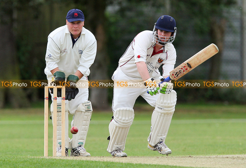 M Squibb looks on from behind the stumps as N O'Brien bats for Colchester - Upminster CC vs Colchester & East Essex CC - Essex Cricket League at Upminster Park - 16/05/09 - MANDATORY CREDIT: Gavin Ellis/TGSPHOTO - Self billing applies where appropriate - 0845 094 6026 - contact@tgsphoto.co.uk - NO UNPAID USE.