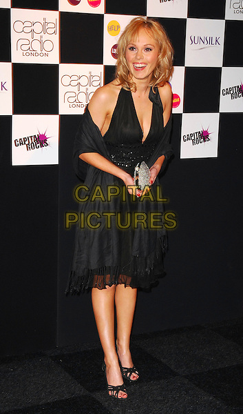 MICHELLE DEWBERRY.At the Capital Rocks! Party, .Battersea Park Events Arena, London, .England, December 12th 2006..full length black dress wrap pashmina.CAP/CAN.©Can Nguyen/Capital Pictures