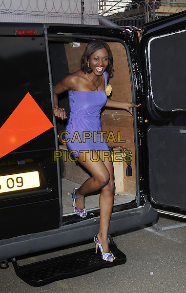 SYLVIA BARRIE.Housemates enter the Big Brother House for Big Brother 9,.Borehamwood, England, 5th June 2008..arrivals full length purple dress yellow flower corsage one shoulder strap getting out of van blue print shoes .CAP/DH.©David Hitchens/Capital Pictures