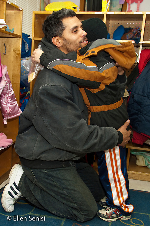 MR / Schenectady, New York. Rainbow Express Childcare Center (private daycare center). Toddler group. Father and son (boy: 4, African American & Caucasian) hug goodbye at arrival time. MR: Har15, Har14. ID: AH-gPre. © Ellen B. Senisi