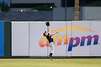 AZL White Sox right fielder JJ Muno (15) makes a leaping catch against the AZL Angels on August 14, 2017 at Diablo Stadium in Tempe, Arizona. AZL Angels defeated the AZL White Sox 3-2. (Zachary Lucy/Four Seam Images)