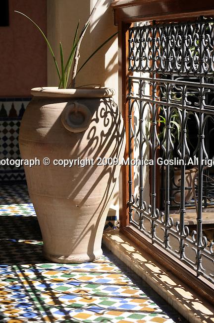 A Pot in a tiled patio in Marrakesh, Morocco.