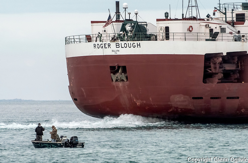 Two unidentified men are seen fishing while the Roger Blough of Duluth Minnesota heads north on Lake Huron to Two Harbors Minnesota.