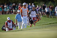 Gainesville, VA - August 2, 2015: Rickie Fowler makes the walk up the 16th hole onto the greens at the Robert Trent Jones Golf Club in Gainesville, VA. August 2, 2015.  (Photo by Philip Peters/Media Images International)