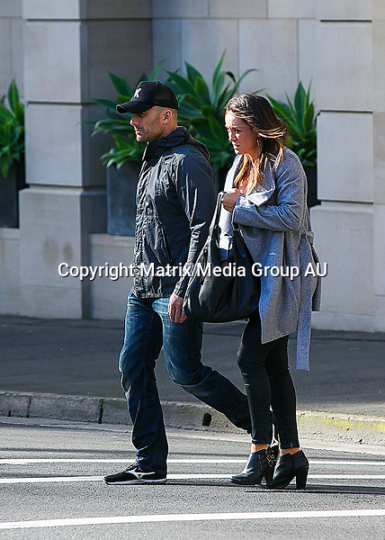 18 JULY 2015 SYDNEY  AUSTRALIA<br /> <br /> EXCLUSIVE PICTURES<br /> <br /> Michelle Bridges pictured looking smitten with her partner Commando Steve Willis on a lunch and shopping outing in Sydney. The couple recently announced they will be having a baby together with Michelle presently four months pregnant. The couple took a taxi from their Potts Point apartment to Pitt Street Mall where they walked arm in arm to the Strand Arcade for a romantic lunch of Italian food at Pendolino. It was then time for some shopping at Hype shoe store where Commando check out some sneakers . It was then onto the Westfield centre where they checked out Saba and other boutiques. Michelle wore a long grey coat which at times revealed the slightest baby belly.<br /> <br /> *No internet without clearance*.<br /> <br /> MUST CALL PRIOR TO USE +61 2 9211-1088. <br /> <br /> Note: All editorial images subject to the following: For editorial use only. Additional clearance required for commercial, wireless, internet or promotional use.Images may not be altered or modified. Matrix Media Group makes no representations or warranties regarding names, trademarks or logos appearing in the images.