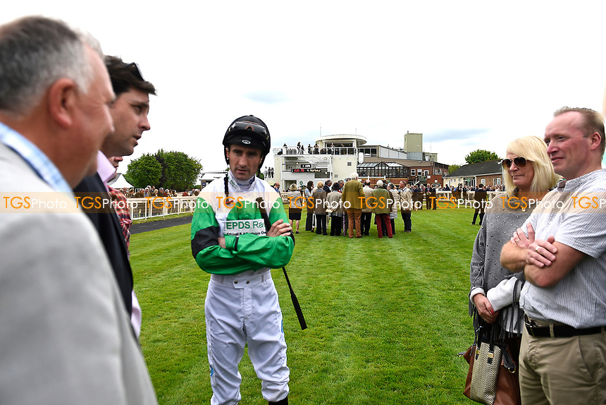 Jockey Dougie Costello chats to the connections of Cecilator in the parade ring  during Afternoon Racing at Salisbury Racecourse on 18th May 2017