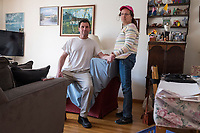 "Carlos Arredondo, 57, (left) and his wife Melida Arredondo, 52, stand in their living room in Roslindale, Boston, Massachusetts, USA, on Sat., March 31, 2018. Arredondo is well known as the ""man in the cowboy hat"" who helped out in the aftermath of the Boston Marathon Bombing in 2013."
