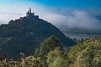 Marksburg Castle in fog,  Rhine River, Germany , Rhineland Region. 13th Century Castle Upper Middle Rhine Valley UNESCO World Heritage Site