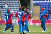 Dawlat Zadran (Afghanistan) and Mohammad Shahzad (Afghanistan) celebrate the wicket of Isuru Udana (Sri Lanka) during Afghanistan vs Sri Lanka, ICC World Cup Cricket at Sophia Gardens Cardiff on 4th June 2019