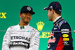(L to R) Lewis Hamilton (Mercedes AMG), Sebastian Vettel (Red Bull), OCTOBER 5, 2014 - F1 : Japanese Formula One Grand Prix Award ceremonyat Suzuka Circuit in Suzuka, Japan. (Photo by AFLO SPORT) [1180] GERMANY OUT