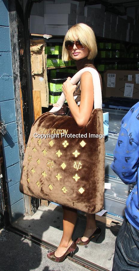 4-28-09.Paris Hilton shopping at Kitson on Robertson blvd with her sister Nicky Hilton ...ABILITYFILMS@YAHOO.COM.805-427-3519.WWW.ABILITYFILMS.COM
