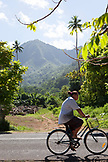 FRENCH POLYNESIA, Moorea. Local man on bicycle on Moorea Island.