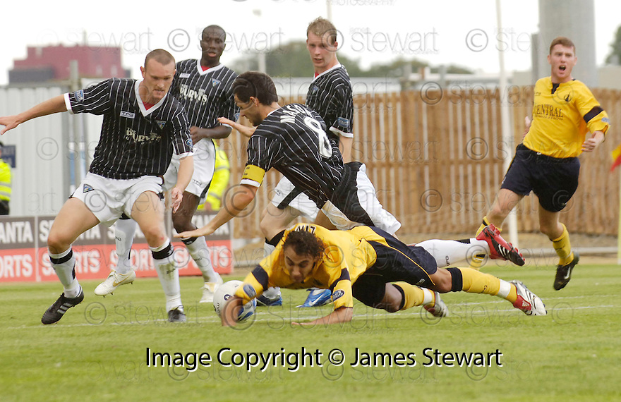 05/08/2006        Copyright Pic: James Stewart.File Name : sct_jspa07_falkirk_v_dunfermline.VITOR LIMA IS BROUGHT DOWN AT THE EDGE OF THE BOX BY GARY MASON.....Payments to :.James Stewart Photo Agency 19 Carronlea Drive, Falkirk. FK2 8DN      Vat Reg No. 607 6932 25.Office     : +44 (0)1324 570906     .Mobile   : +44 (0)7721 416997.Fax         : +44 (0)1324 570906.E-mail  :  jim@jspa.co.uk.If you require further information then contact Jim Stewart on any of the numbers above.........