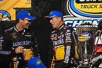 Nov. 20, 2009; Homestead, FL, USA; NASCAR Camping World Truck Series team owner Kevin Harvick (left) with driver Ron Hornaday after winning the truck series championship following the Ford 200 at Homestead Miami Speedway. Mandatory Credit: Mark J. Rebilas-