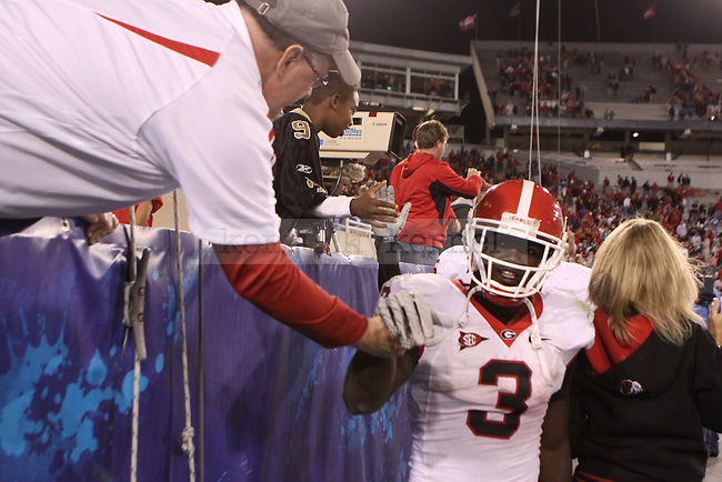 Georgia tailback Washaun Ealey celebrates with fans after running for 157 rushing yards and scoring five touchdowns in the 44-31 victory over Kentucky at Commonwealth Stadium on Saturday, Oct. 23, 2010. Photo by Scott Hannigan | Staff