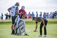 Danny Willett (GBR) and Zach Johnson (USA) prepare to call an official over to rule on Johnson's footing near a sprinkler head during Thursday's round 1 of the 117th U.S. Open, at Erin Hills, Erin, Wisconsin. 6/15/2017.<br /> Picture: Golffile | Ken Murray<br /> <br /> <br /> All photo usage must carry mandatory copyright credit (&copy; Golffile | Ken Murray)