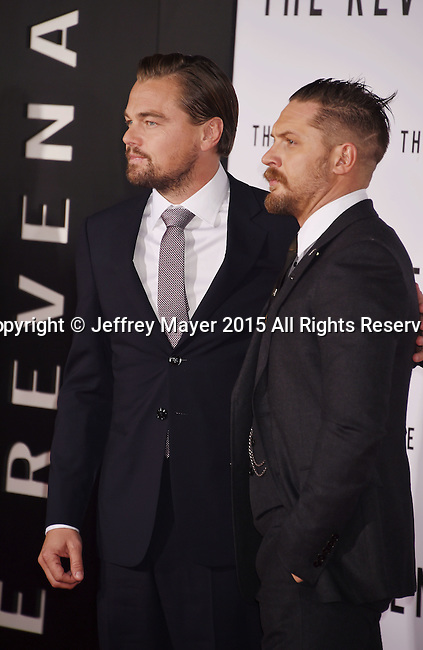 HOLLYWOOD, CA - DECEMBER 16: Actors Leonardo DiCaprio (L) and Tom Hardy arrive at the Premiere of 20th Century Fox And Regency Enterprises' 'The Revenant' at TCL Chinese Theatre on December 16, 2015 in Hollywood, California.