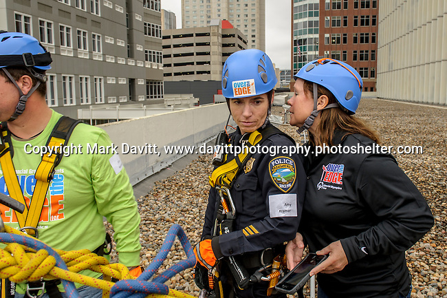 "Captain Kramer listens to Michelle Leonard, Dallas Center Police during her rappelling instructions for ""Over the Edge"" in support of Special Olympics Iowa Oct. 26. Leonard raised $1,000 to support  the cause but was not able to go because of a hand injury."
