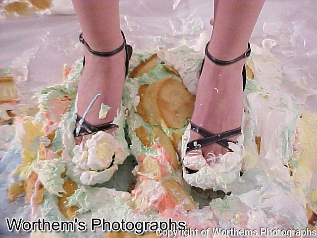 This beautiful model's feet looks so cute covered in whipped cream pie.