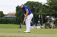 Paul Dunne (Europe) on the 16th green during the Singles Matches of the Eurasia Cup at Glenmarie Golf and Country Club on the Sunday 14th January 2018.<br /> Picture:  Thos Caffrey / www.golffile.ie