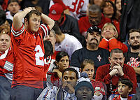 Ohio State Buckeyes fans found it hard to watch the 4th quarter while losing to Michigan State Spartans in the Big 10 Championship game at Lucas Oil Stadium in Indianapolis, Ind on December 7, 2013.  (Dispatch photo by Kyle Robertson)