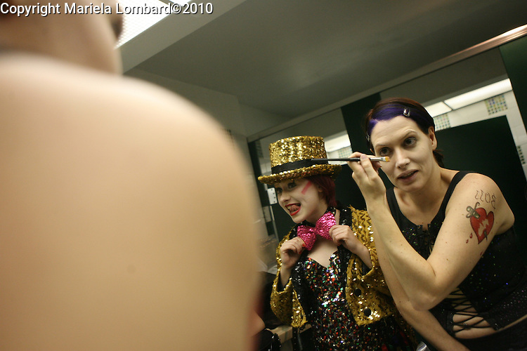 "Jen DiMatteo (""Frankenfurter""), on right, and Sophie Manevich (""Columbia""), on left, getting into costume before hitting the stage to perform The Rocky Horror Picture Show at the Chelsea Clearview Theatre in Manhattan.  DiMatteo auditioned and won the lead role in the 35th Anniversary floor show to be held in Los Angeles next week reuniting members of the film's cast and fervent fans from all over the country."